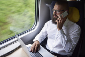 Businessman while journey by train receiving training online